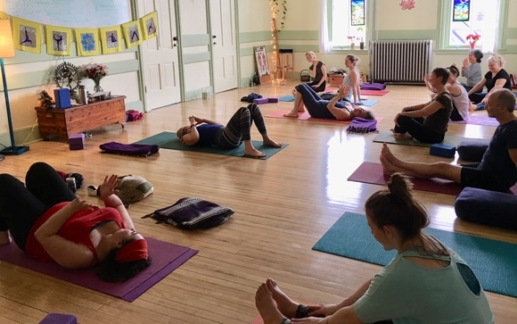 ladies on floor mats in a Yoga class