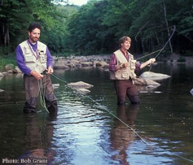 two men standing in the water fly fishing