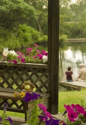 couple near the pond and gazebo on the grounds of Rabbit Hill Inn