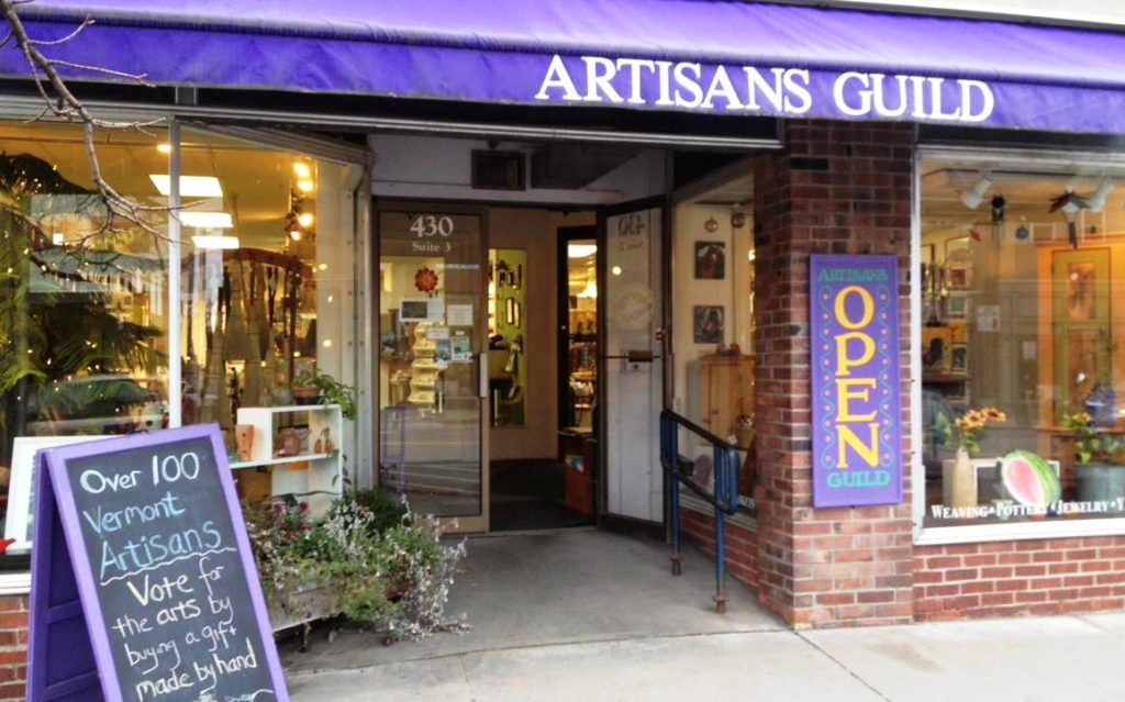 front entrance and sign of the Northeast Kingdom artisans guild craft gallery St Johnsbury Vermont