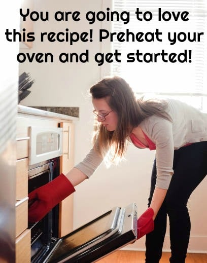 woman reaching into oven