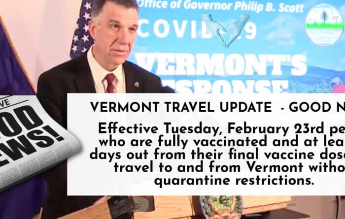 Vermont Governor Phil Scott standing at a podium during press conference
