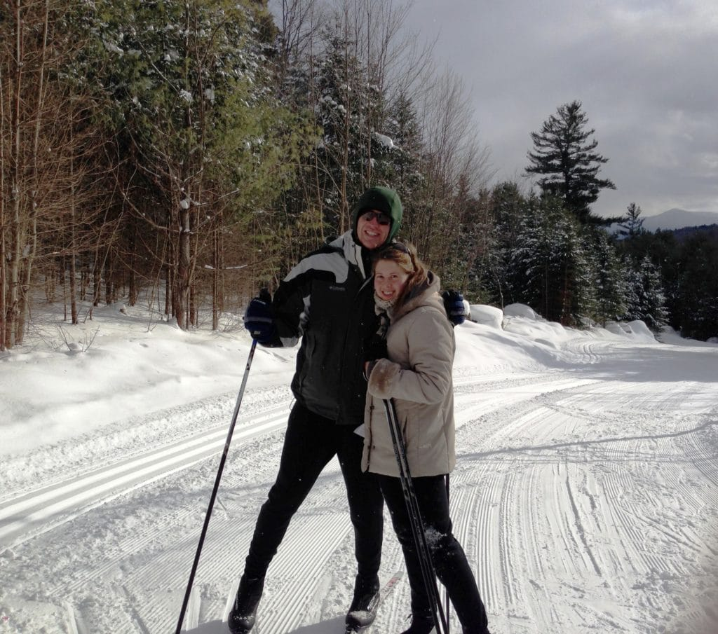 Couple cross country skiing at Ski Hearth Farm