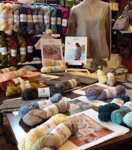 table of yarns at a yarn shop