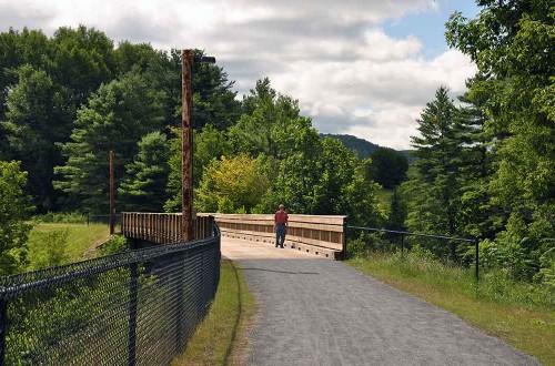 man standing on road at Three Rivers Bike path St. Johnsbury VT near Rabbit Hill Inn