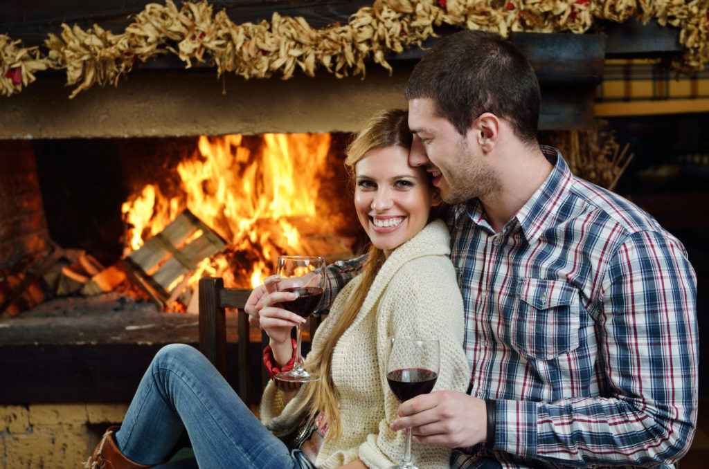 romantic couple by the fire