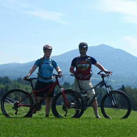 bikers at kingdom trails with Burke Mountain in the background