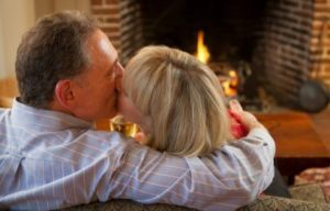 romantic couple by the fire at Rabbit Hill Inn