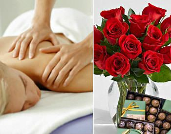 lady getting massage. roses and box of chocolates