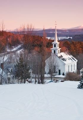 Rabbit Hill Inn land overlooking the White Village of Vermont covered in snow at sunrise