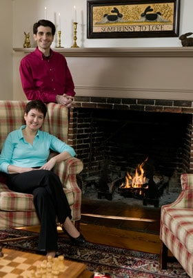 Rabbit Hill Inn Innkeepers Brian and Leslie Mulcahy in front of the living room fireplace