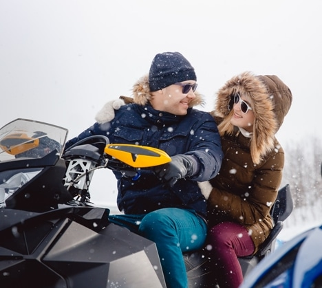 couple on a snowmobile