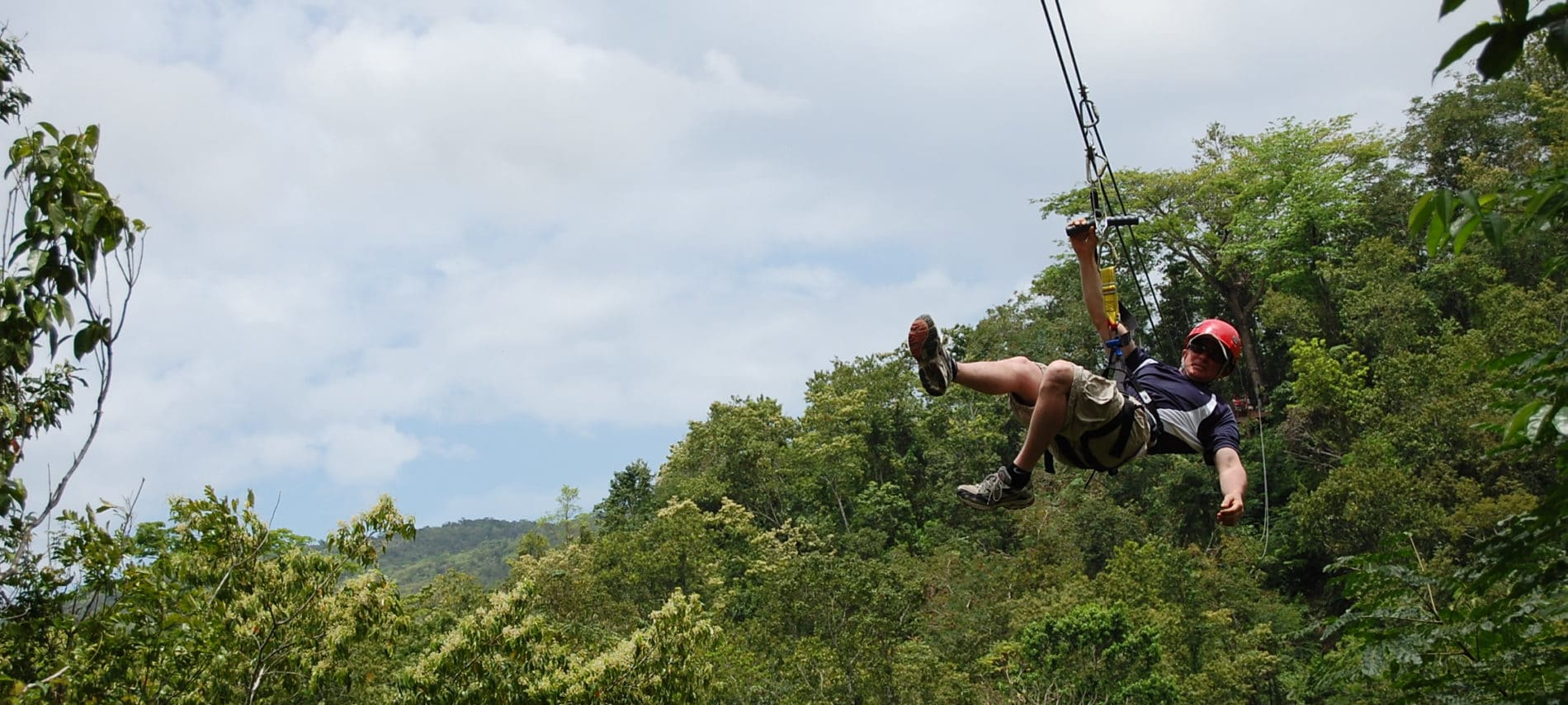 Man on a zipline at Alpine Adventures Zipline tours